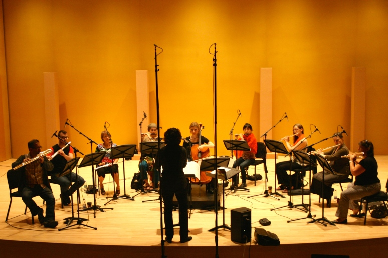 Véronique Lacroix directing the flute ensemble of the ECM+ for the recording of Fitzell's Magister Ludi.
